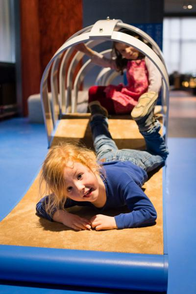 As your child will find out in this mini obstacle course, crawling is harder on some surfaces than on others.