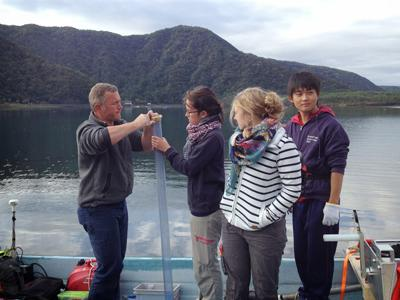 Geologists drill coring on a Japanese lake