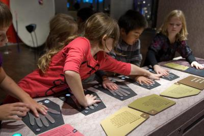 Children trying to gauge different temperatures with hands