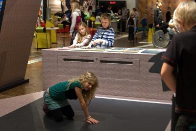 Child trying to feel differences of the temperature on a special floor