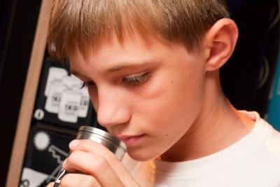 A young visitor smells the first sample. What about you, do you smell good?